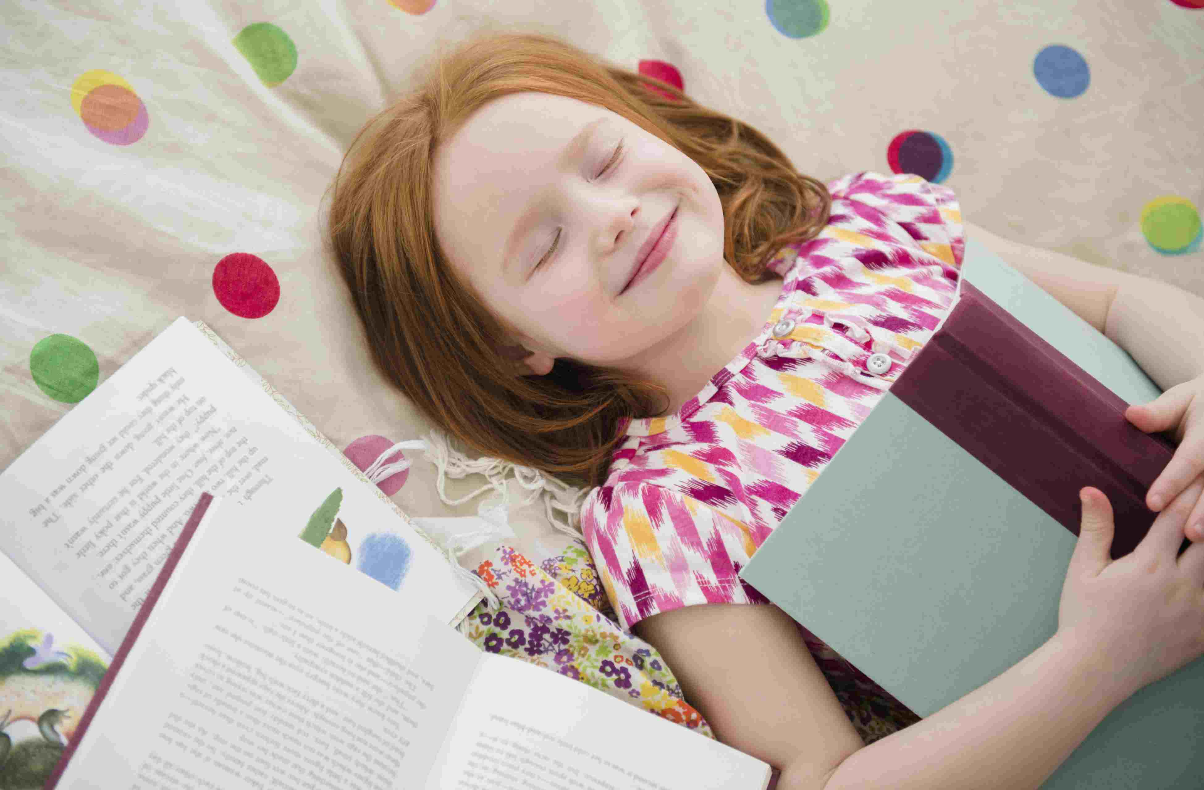girl smiling with books, loves reading