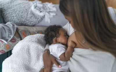 Woman nursing her infant
