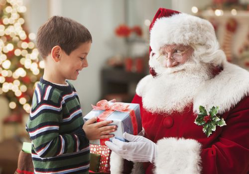 Young boy visiting with Santa