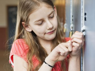 Girl opening a locker