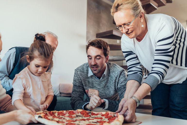 Shot of a happy family having pizza