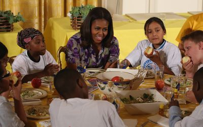 Obesity quotes - Michelle Obama sharing meal with students