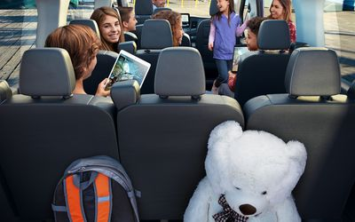 Ford Transit Interior with large family on smart devices