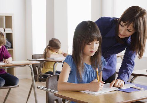 Schoolgirl with teacher