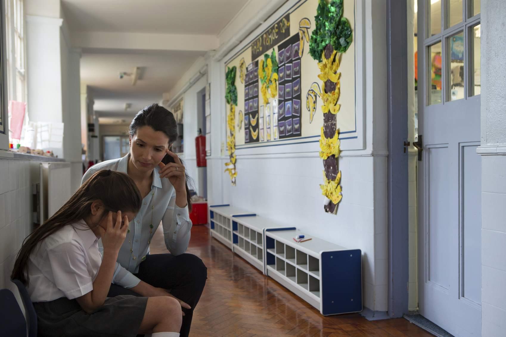 Teacher with an upset student