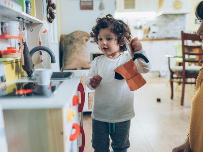 Child play in toy kitchen