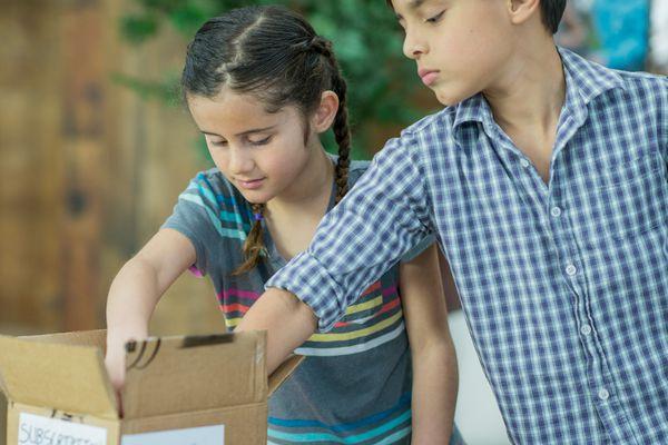 Kids reaching into a box