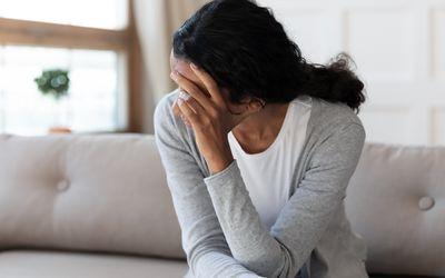 Unhappy biracial woman look in distance feeling depressed
