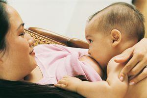 Woman breastfeeding her son