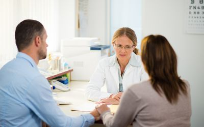 Couple in a consultation with a doctor