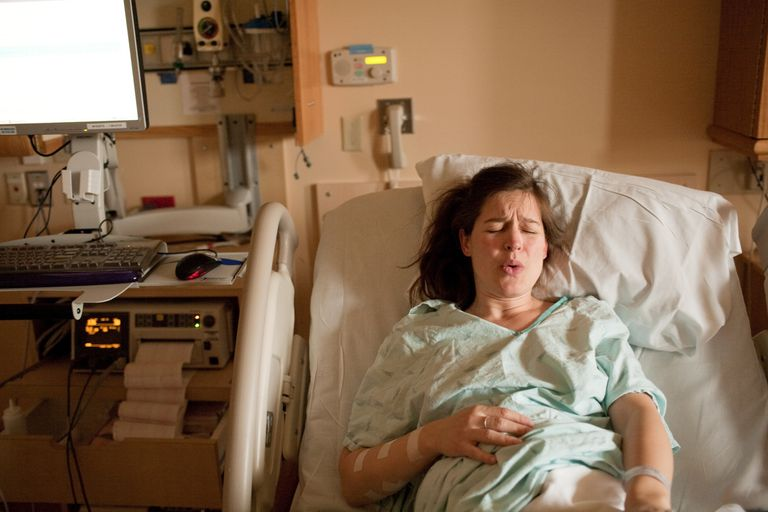 Woman in labor in hospital bed
