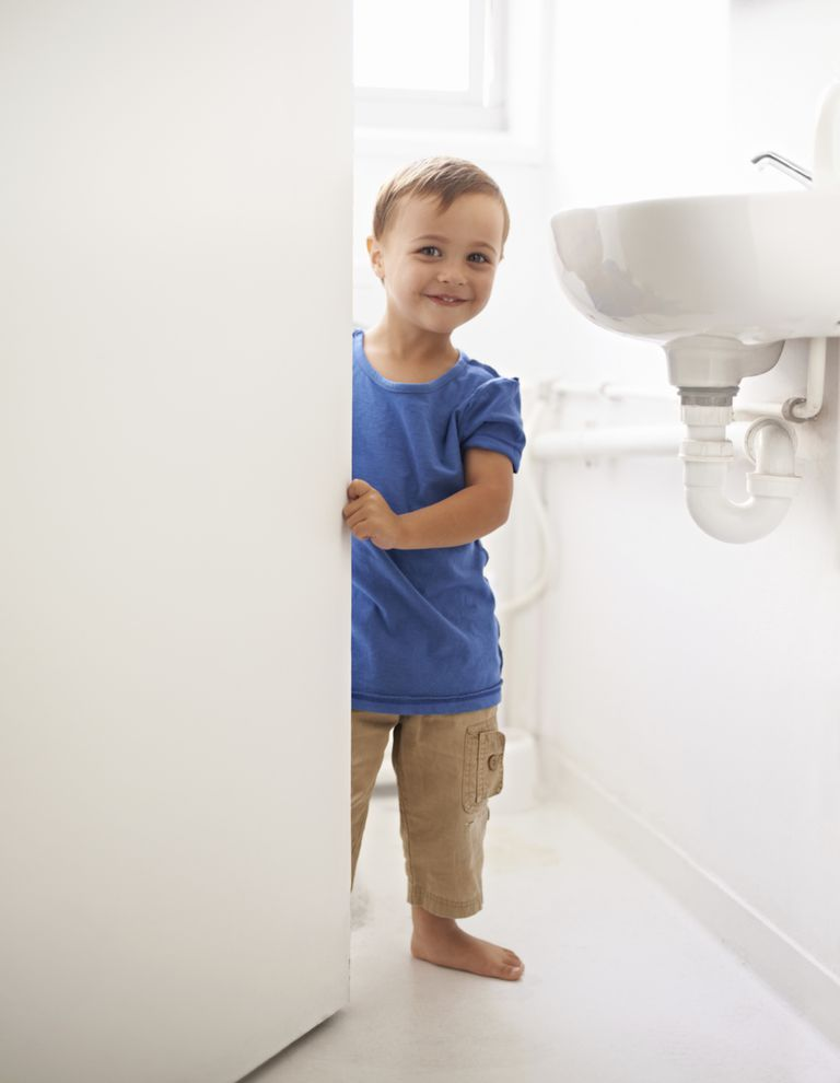 little boy going to bathroom by himself
