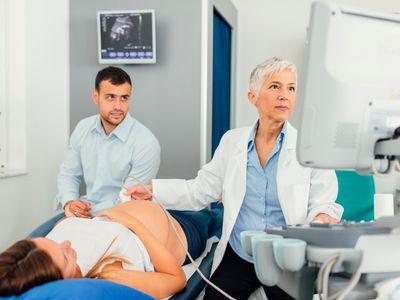 A pregnant woman getting an ultrashound