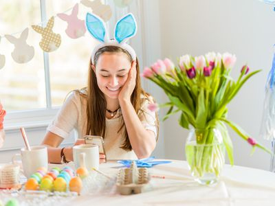 young teen girl dying Easter eggs
