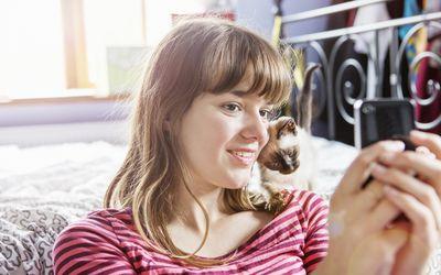 Girl taking selfie with a kitten