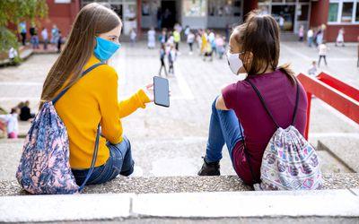 two middle school girls talking outside