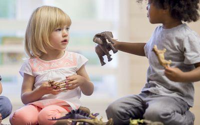 Preschoolers Sharing Toys