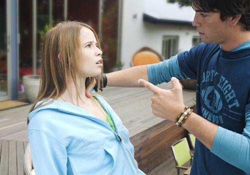 Teenage boy scolding teenage girl