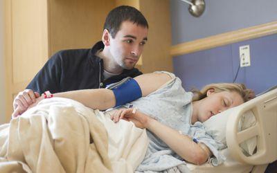 Man helping a woman in childbirth