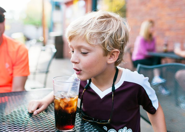 Boy drinking soda