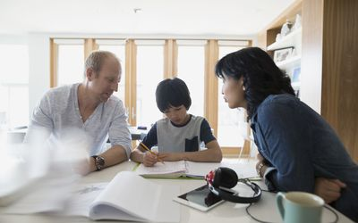 Parents helping child with homework