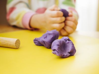 Child playing with playdough