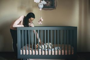 Mom putting baby to sleep