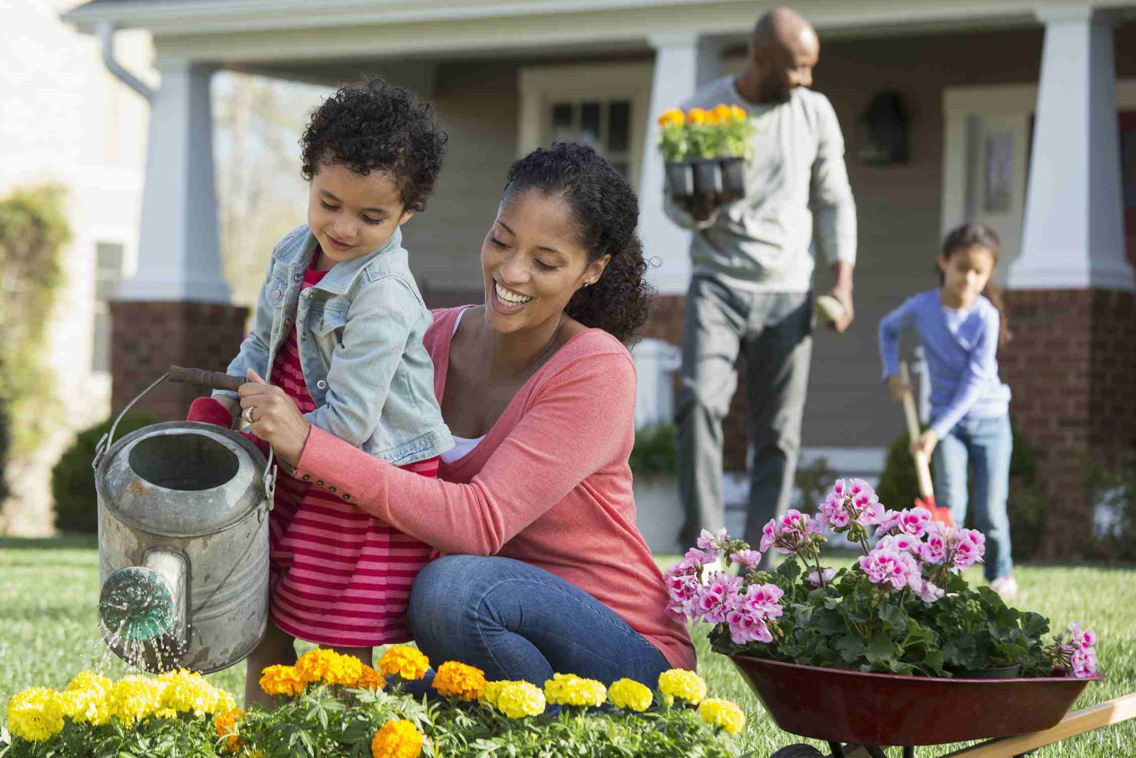 A picture of a mom and daughter gardening