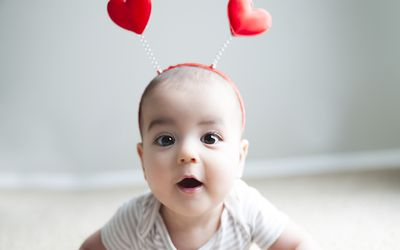 Valentine's Day Baby Poses for Camera