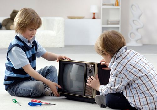 Two Boys Taking TV Apart