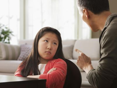 Father lecturing daughter