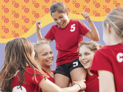 Children in matching sports uniforms cheering