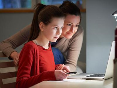 Mom and daughter at computer