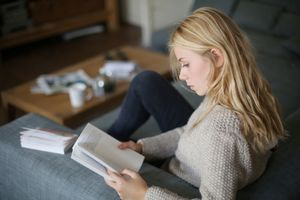 A 18 years old young woman reading a book