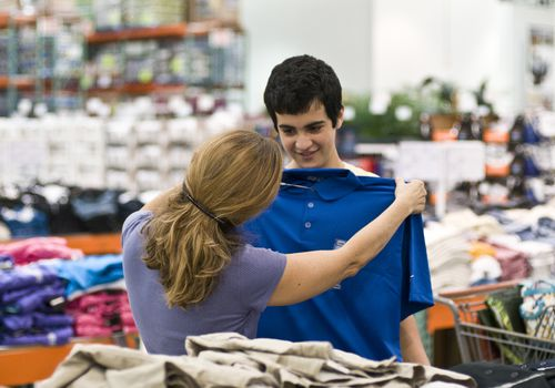 Mother and son shopping for clothes