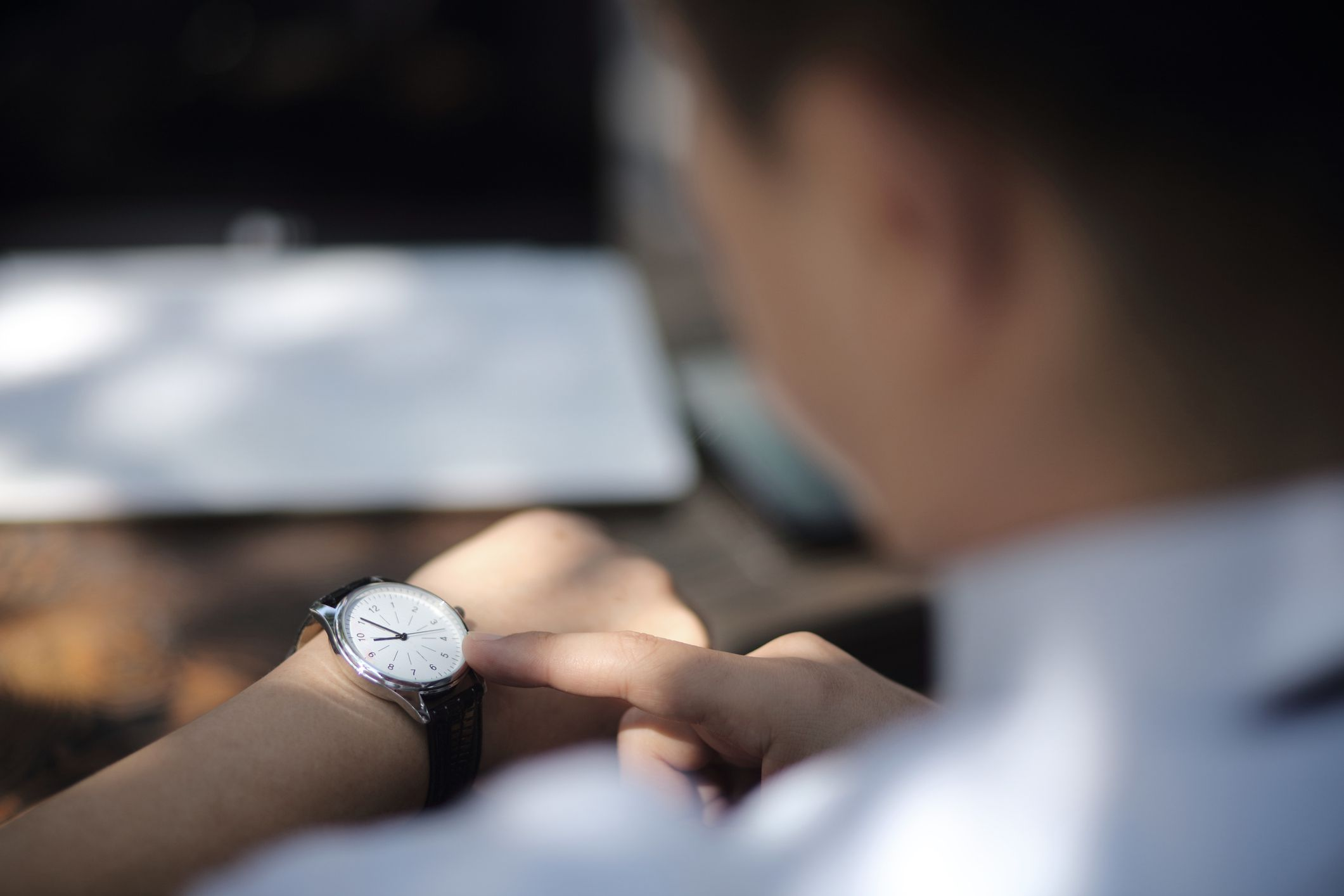 Man checking the time on his watch