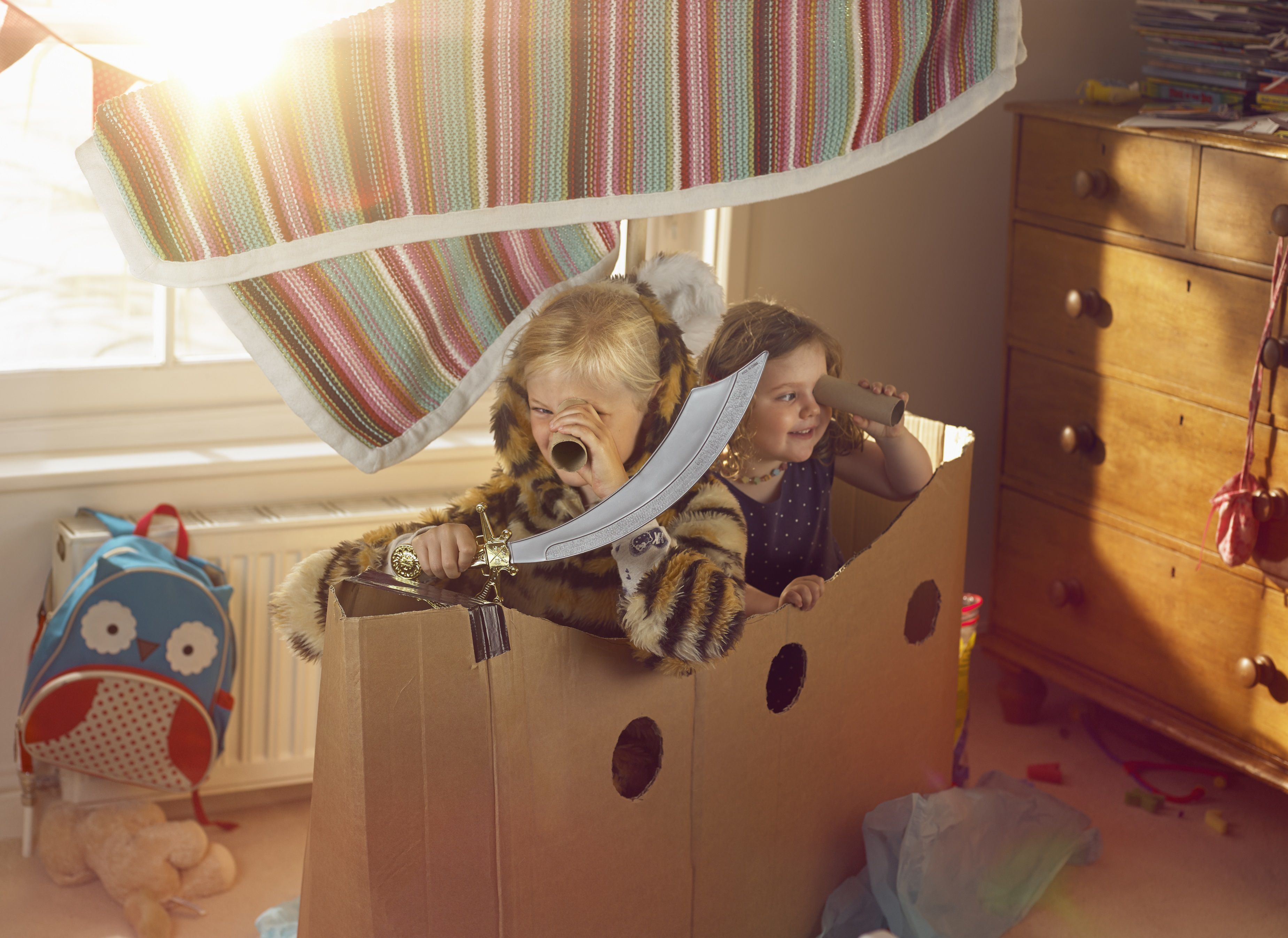 pretend play - girls in cardboard box playing pirates