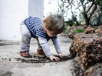Boy playing in the garden