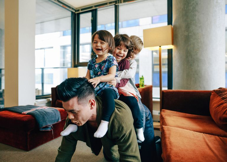 Kids playing with dad