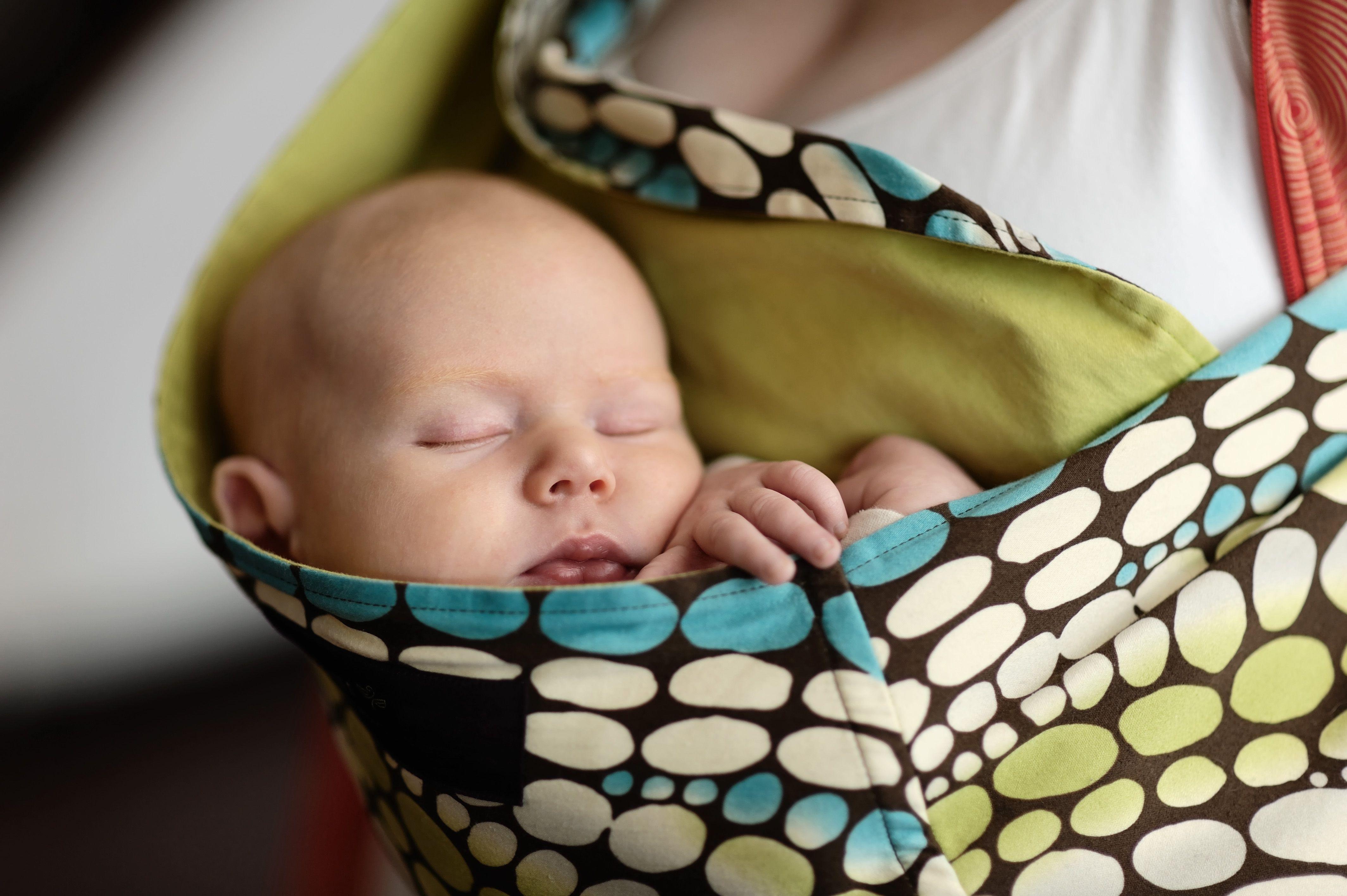 Sleeping baby in a sling