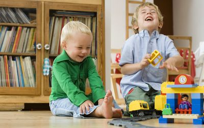 toddler boys playing with trains