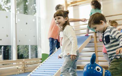 Happy children in gym room in kindergarten