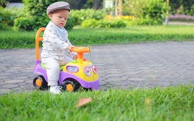 Baby on ride-on toy