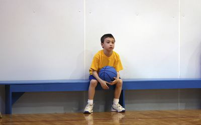 hate sports - boy sitting on bench