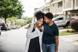 Couple walking in residential neighborhood