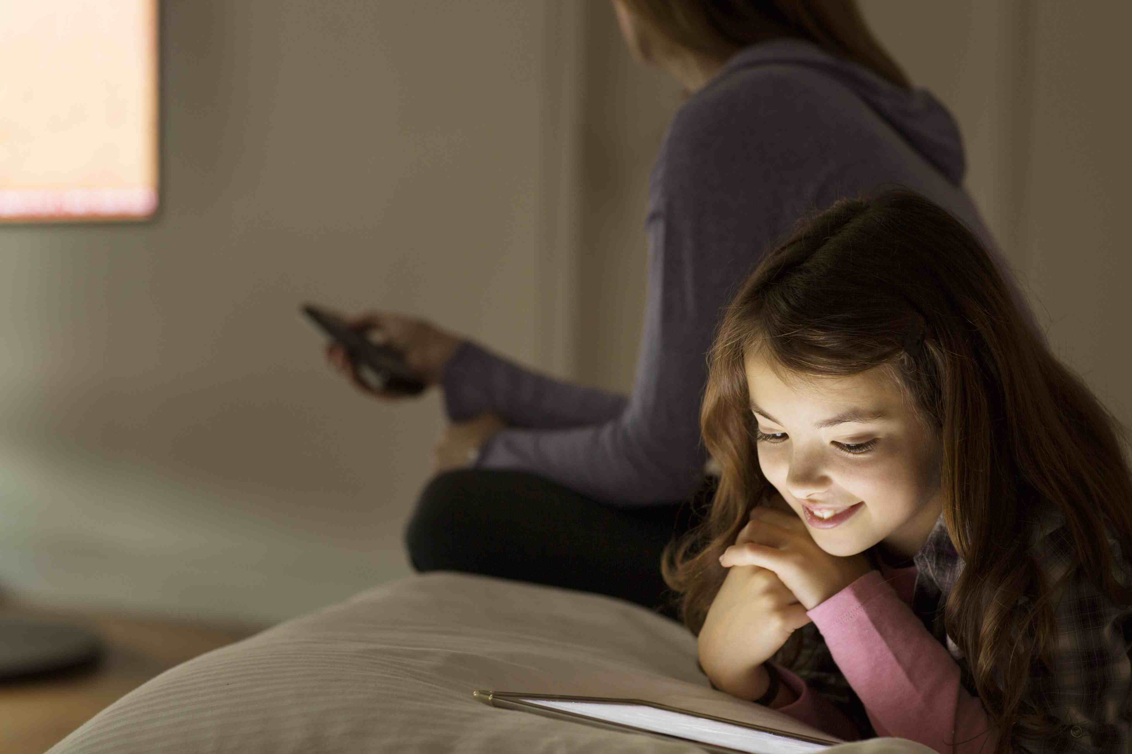 girl watching tablet at night - kids' sleep problems