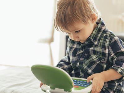 Boy using top laptop