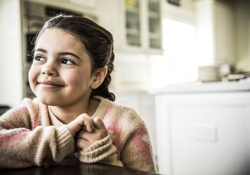 Little girl smiling indoors