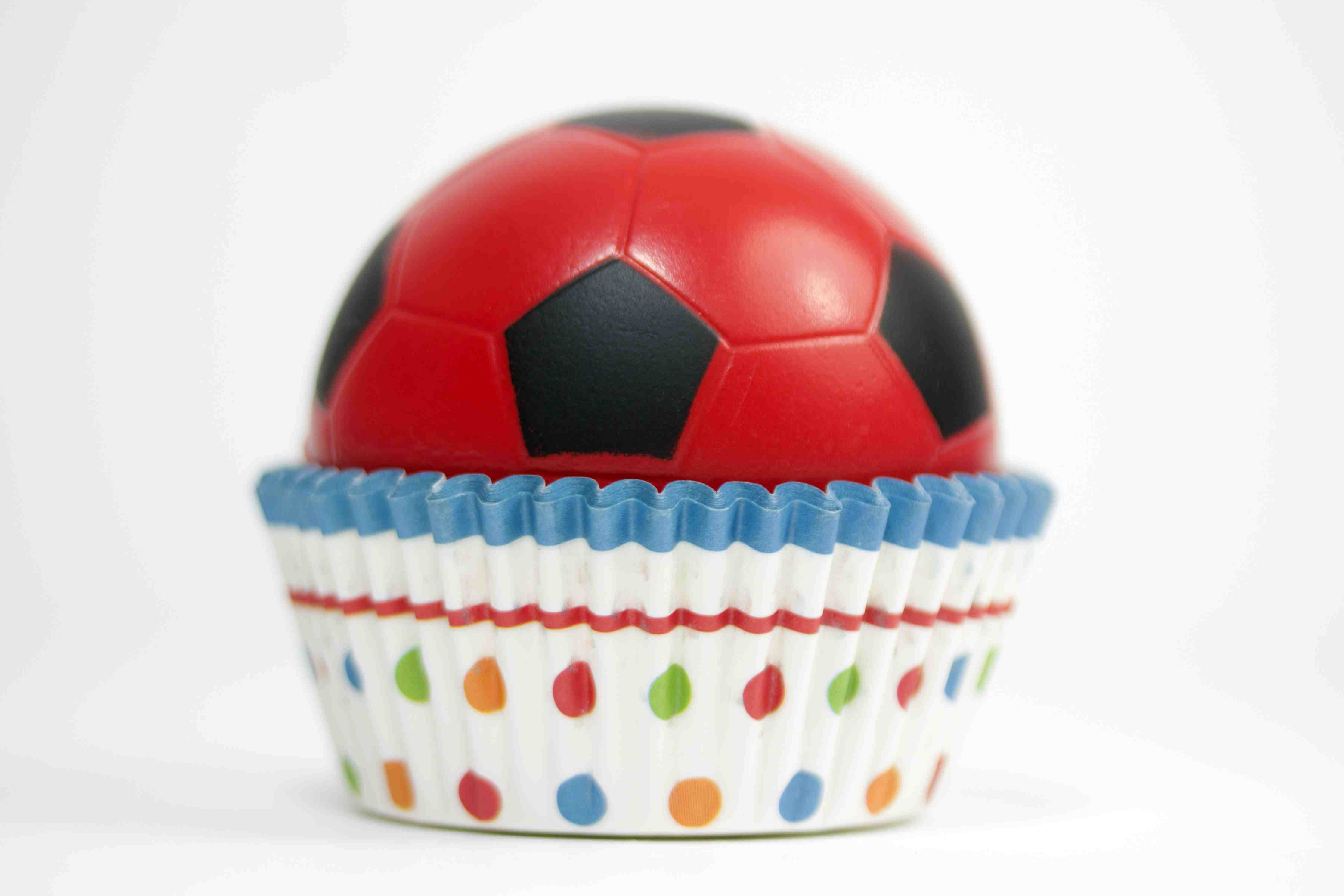 Soccer ball inside a colorful cupcake