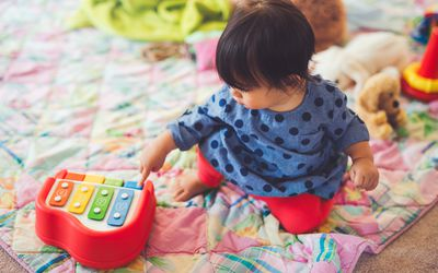 Baby With Small Learning Piano
